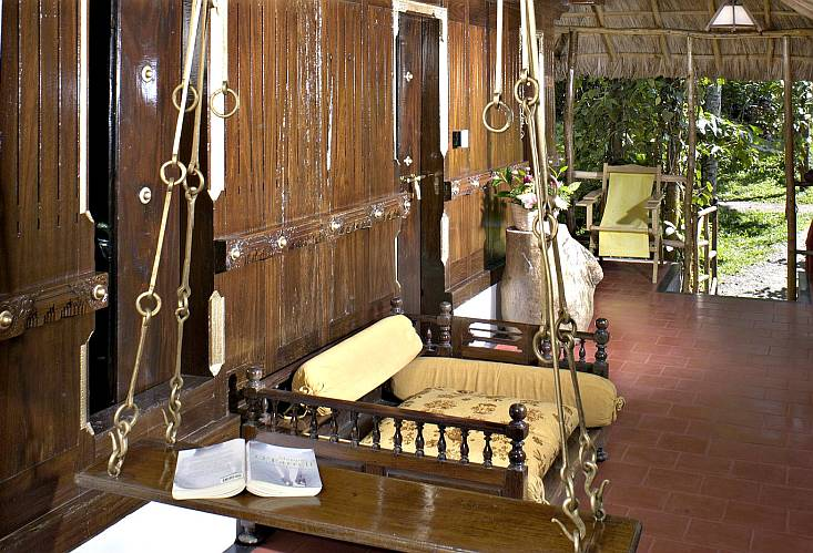 While some cottages at Shalimar are built in modern European style, others are constructed in the traditional Kerala style of architecture called Nalukettu, with wooden flooring and carvings and slotted wood on the ceiling and doors—complete with an Aattu Kattil (swinging wooden bed) oscillating in the sit out area